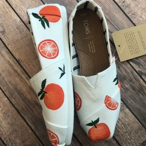 Hand painted orange toms, size 6.5